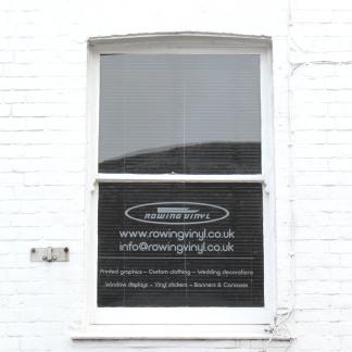 Self-adhesive vinyl window signage