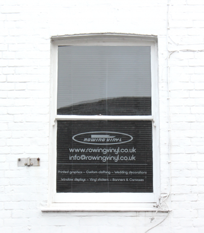 Self-adhesive vinyl window signage